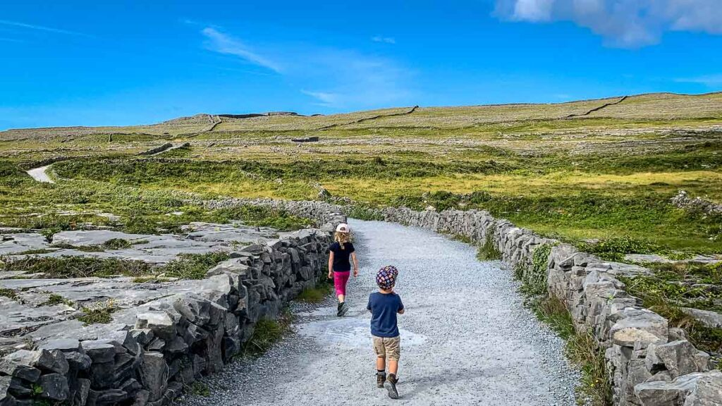 image of kids walking on trail up to Dun Aonghasa on Inishmore Aran Island