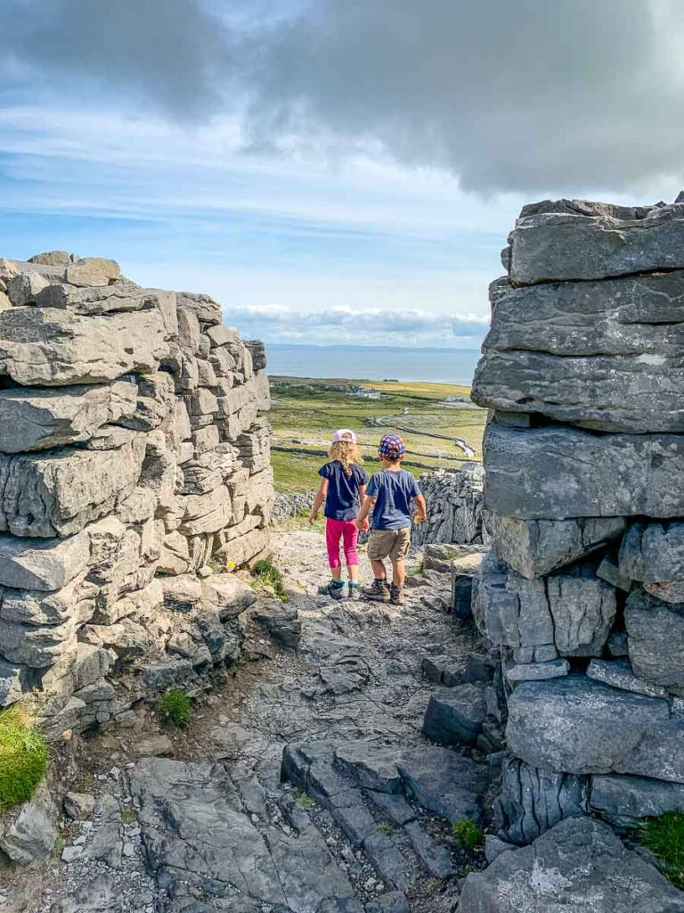 image of two kids walking down from Dun Aonghasa on Inishmore Island