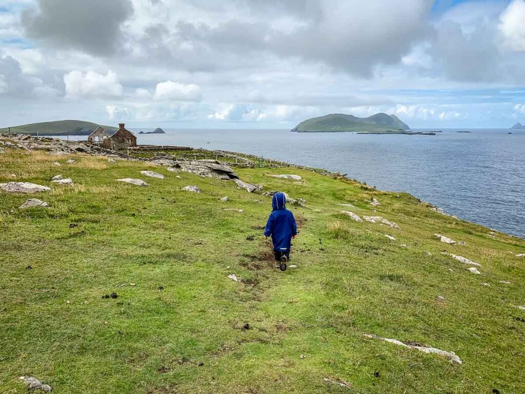 Image of boy in blue rain jacket hiking Dun Chaoin Coastal Loop on Dingle Peninsula