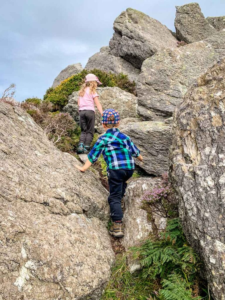 image of kids climbing over large rocks on Dingle Peninsula