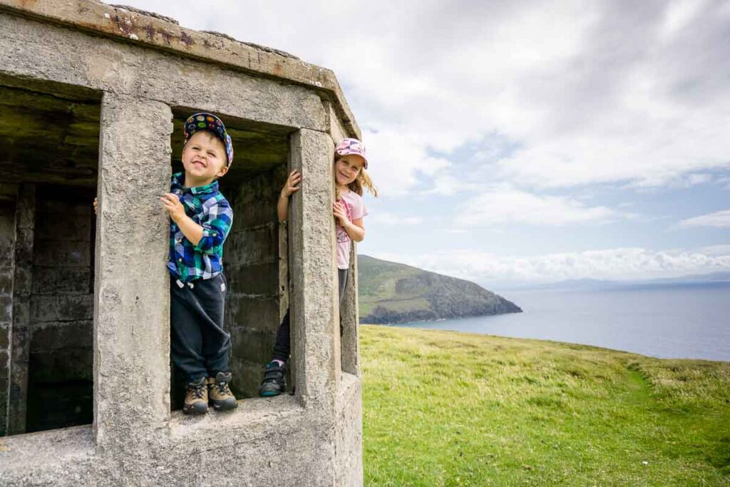 image of two kids standing in stone structure along Dunmore Head Loop