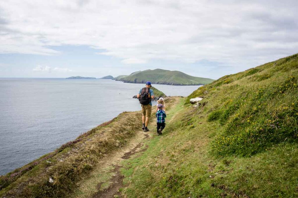 image of man and two kids walking along trail of Dunmore Head Loop on Dingle Peninsula Ireland