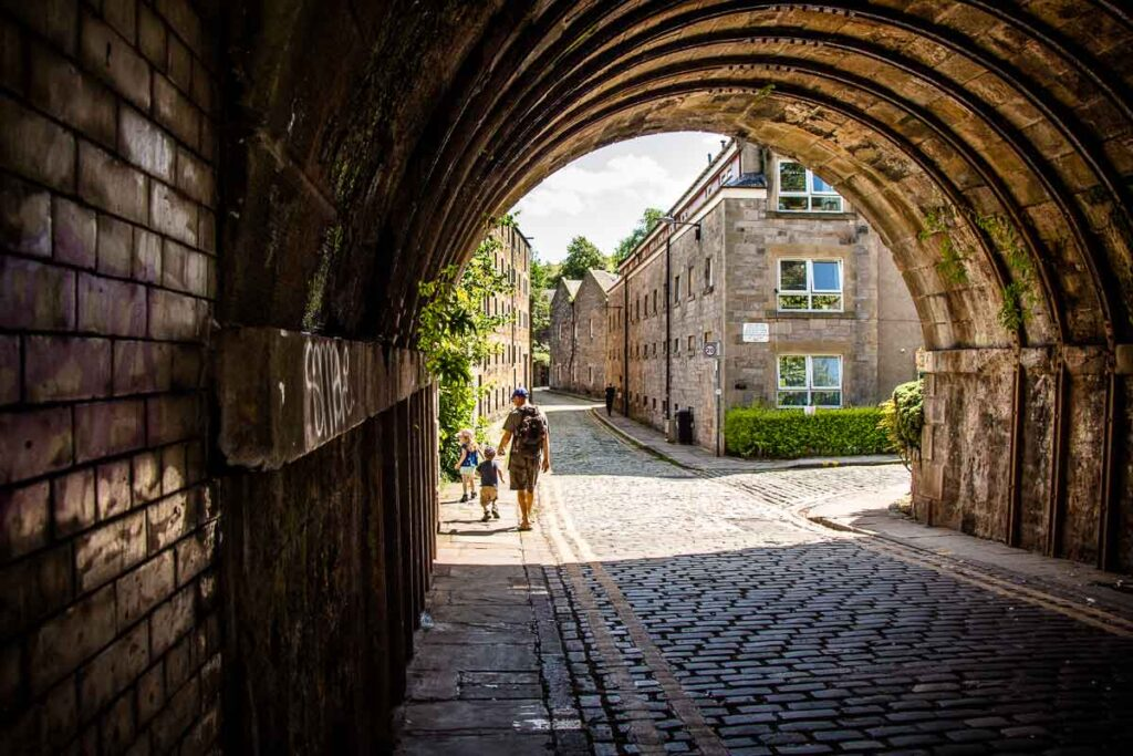 Image of cobblestone street under bridge in Edinburgh Scotland