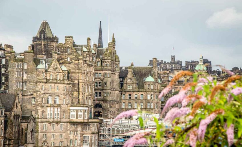image of buildings with pink flowers in the foreground in Edinburgh Scotland