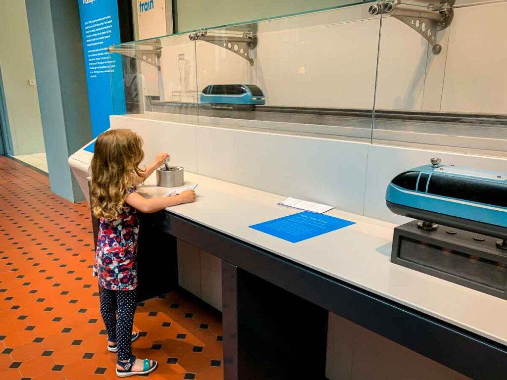 image of girl playing with train in National Museum of Scotland in Edinburgh