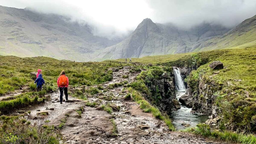 image of mother and kids hiking on Isle of Skye
