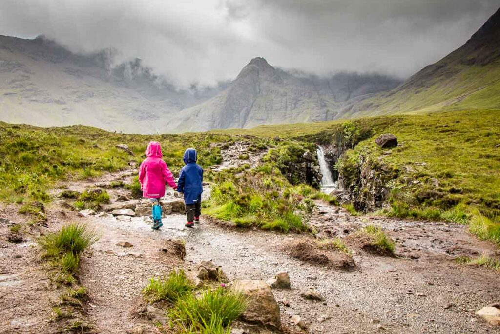 image of kids hiking the Fairy Pools hiking trail on Isle of Skye