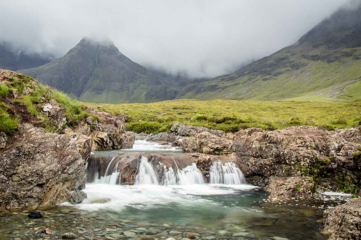 image of waterfall and blue pools on Fairy Pools Isle of Skye hike