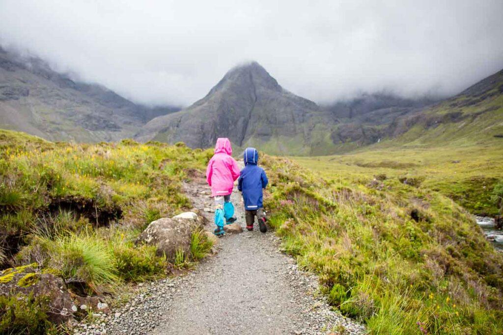 image of two kids on fairy pools walk on Isle of Skye