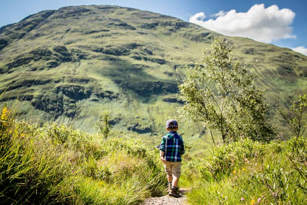 image of boy hiking in scotland