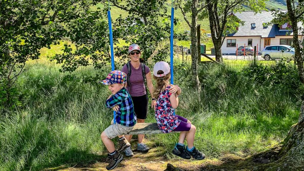 image of kids on swing next to the start of the Falls of Glomach Circular Walk trail