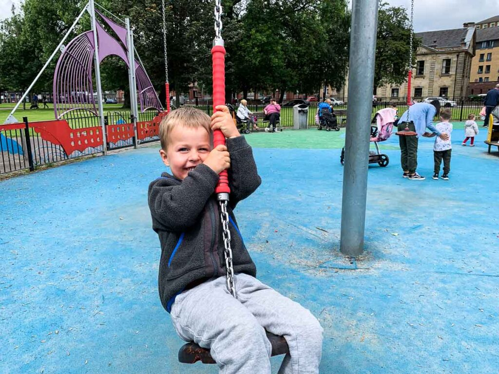 image of boy on playground in Glasgow Scotland