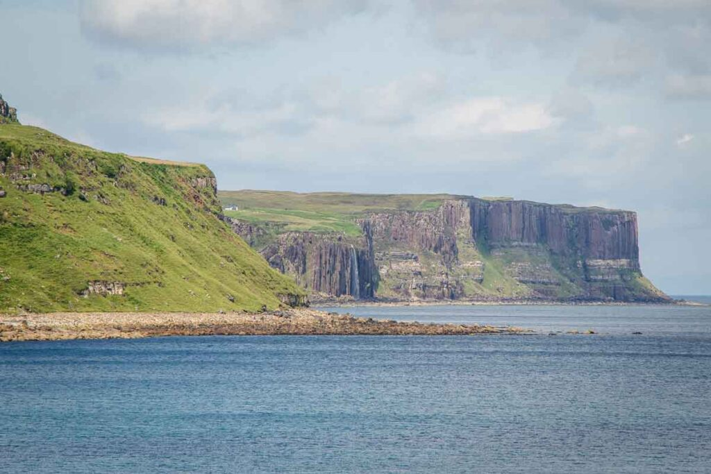 image of cliffs and waterfall that drop down to the ocean on Isle of Skye, Scotland