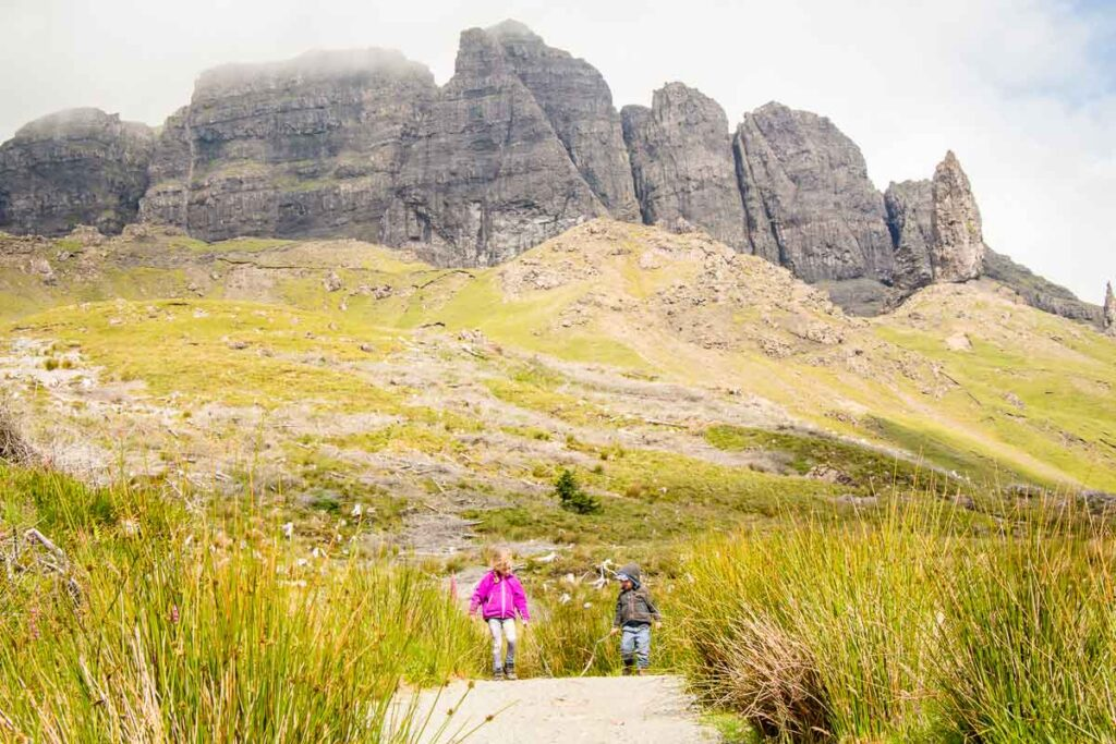 image of children walking only path from old man of storr isle of skye scotland
