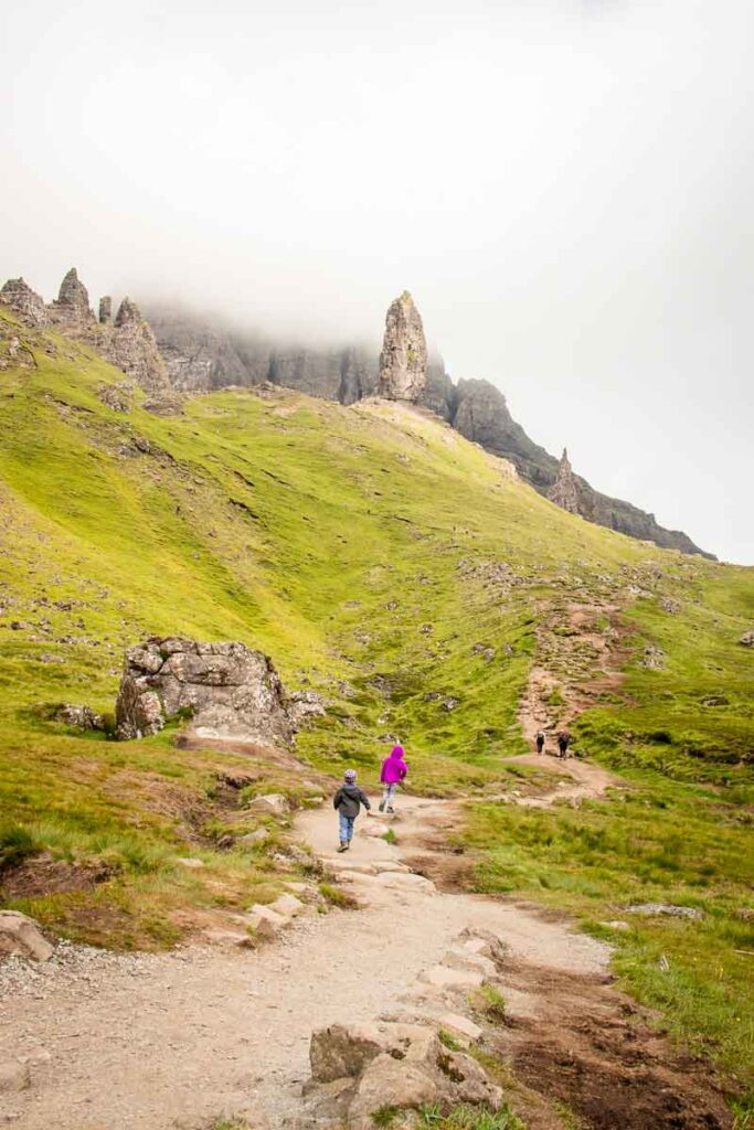 image of people hiking up to the old man of storr on the isle of skye in scotland