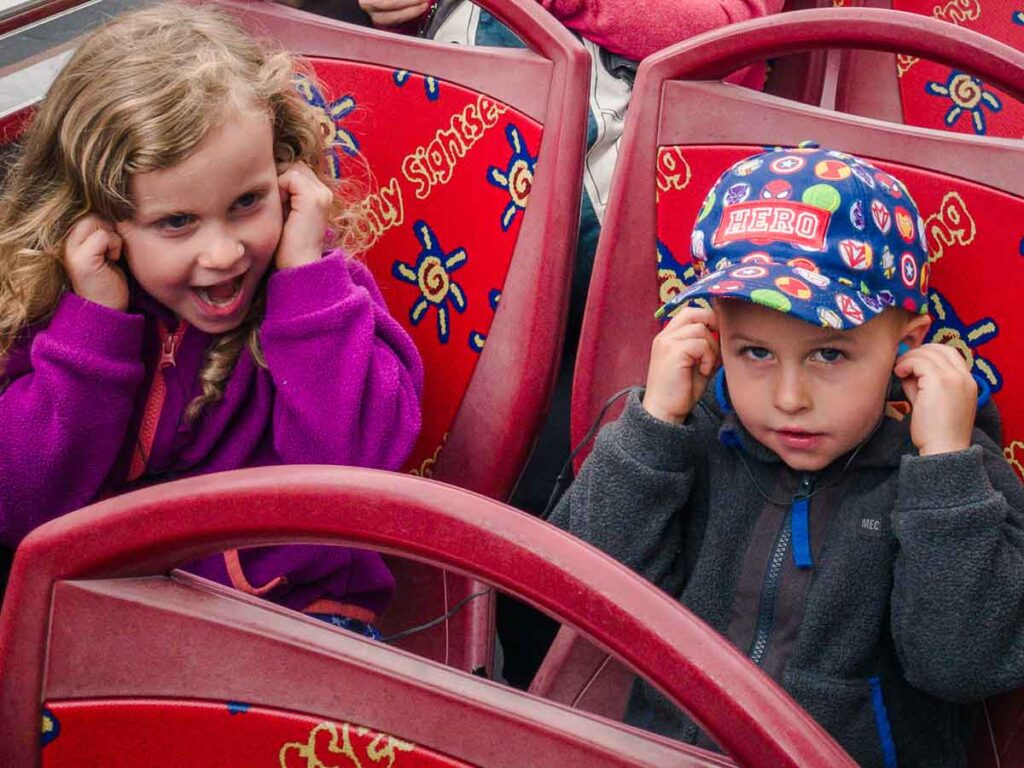 image of two kids on City Sightseeing Hop On Hop Off Bus in Glasgow Scotland