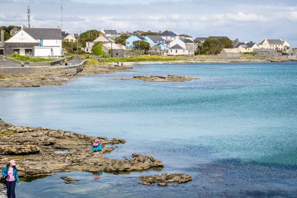 Image of water with road and houses on Inis Mor Island Ireland