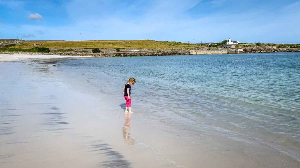 image of girl playing in the water on Kilmurvey Beach on Inis Mor Aran Island in Ireland