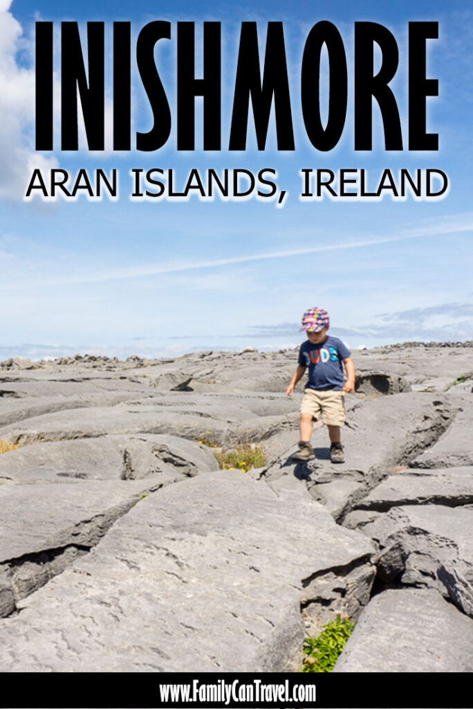 image of boy walking across large grey rocks with text overlay of Inishmore Aran Islands Ireland