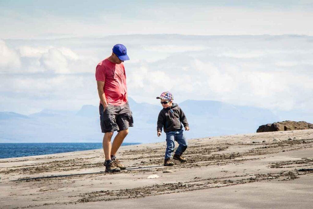 image of father and boy on slipaway beach on isle of skye