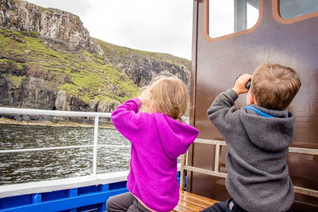 image of two kids with binoculars on a boat cruise isle of skye