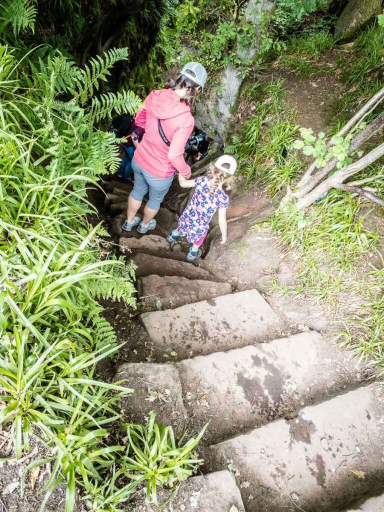 image of mother holding girls hand walking down stairs to Devil's Pulpit