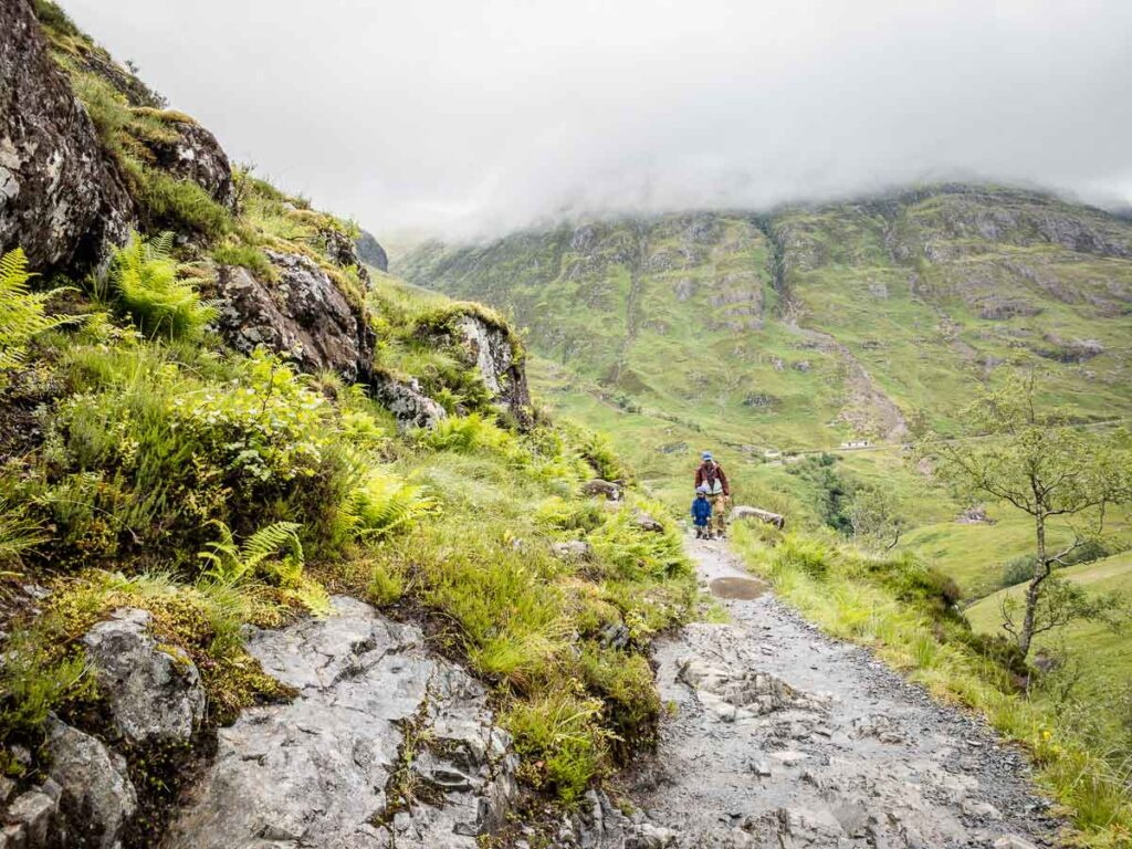 image of father and boy hiking in Glencoe Scotland