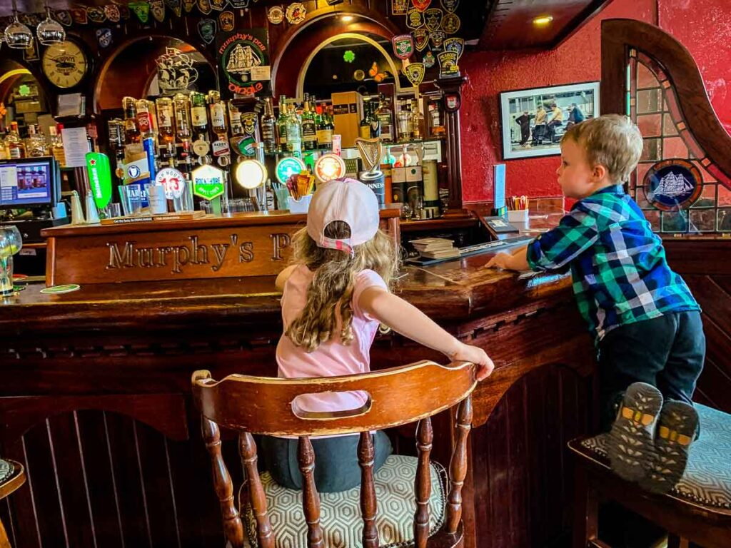 image of two kids sitting at pub in Dingle Peninsula Ireland