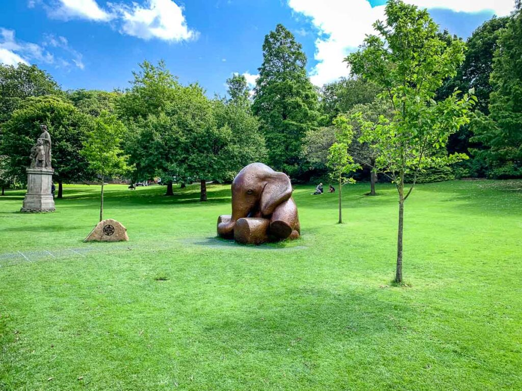 "image of baby elephant sculpture named ""Lulla-Bye"" in Princes Street Gardens in Edinburgh Scotland"