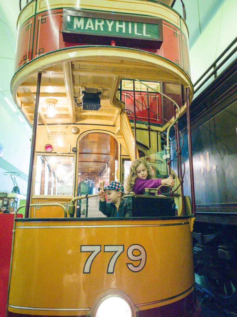 image of kids in a trolley inside Riverside Museum in Glasgow Scotland