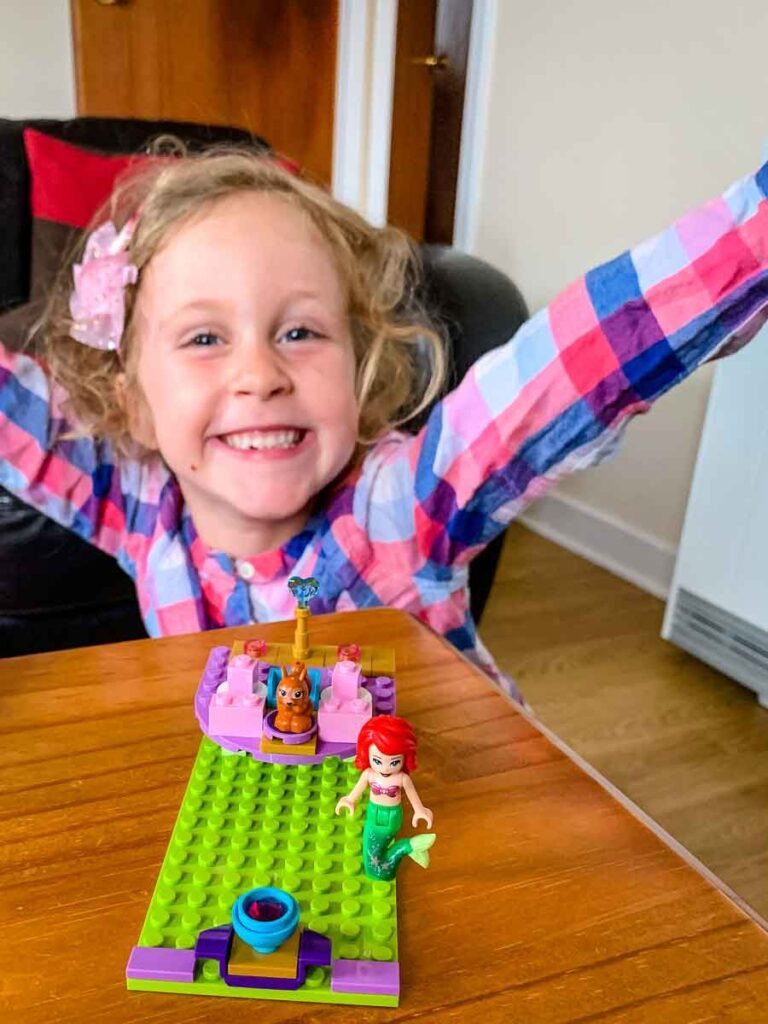 image of girl posing with lego