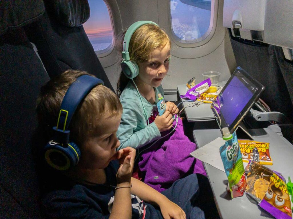 image of flying with kids wearing headphones
