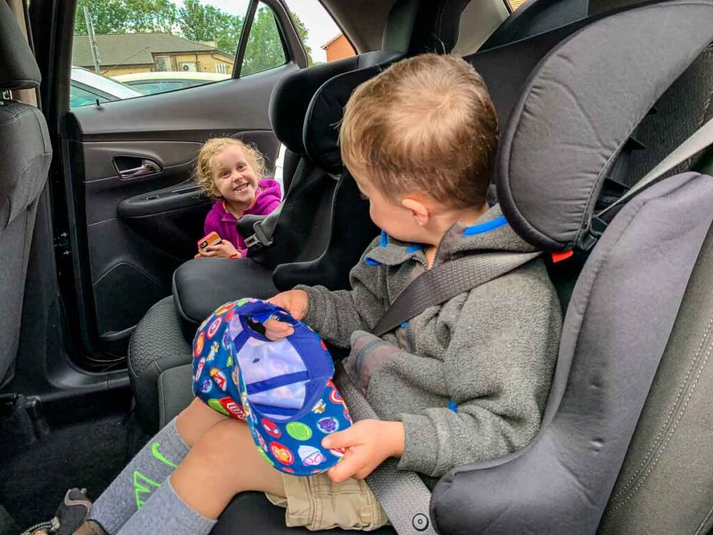 image of two kids in rental car in Scotland