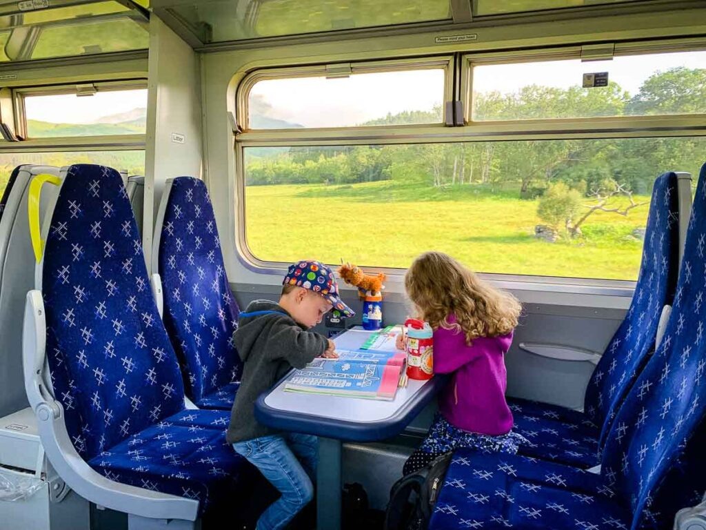 image of two kids on a train in Scotland