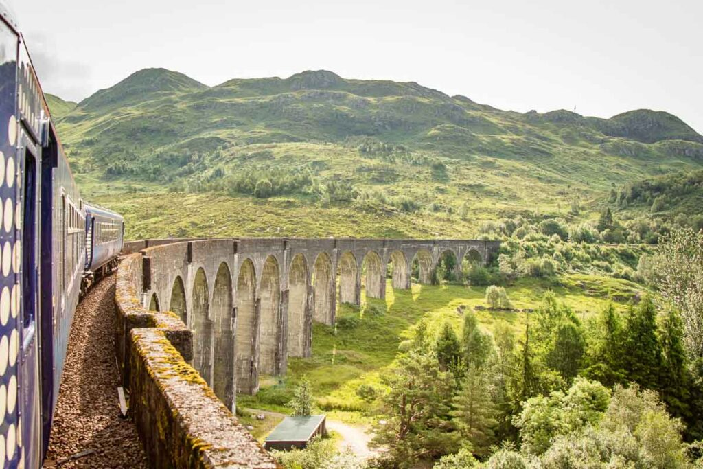 image of train going over Harry Potter Bridge in Scotland