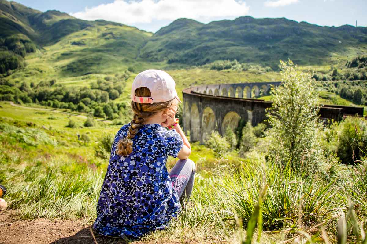 image of girl watching Glenfinnan Viaduct for Hogwarts Express