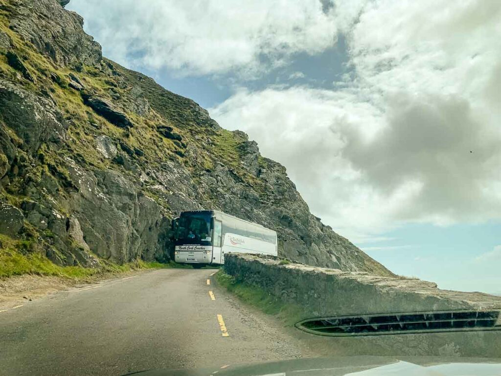 image of bus driving along narrow Slea Head Drive on Dingle Peninsula
