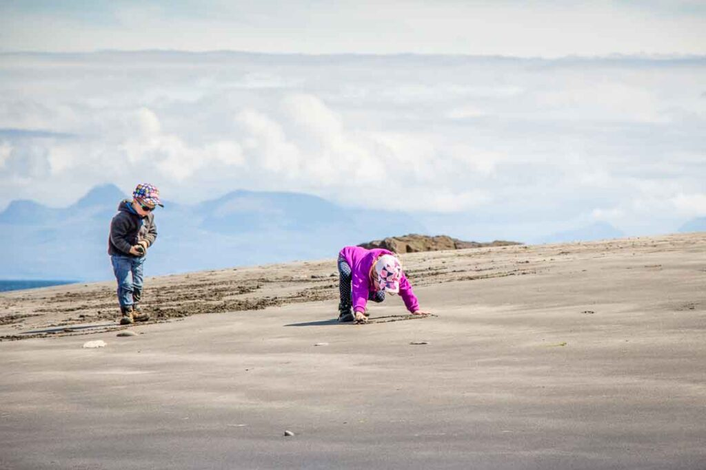 image of two kids playing on Slipaway Beach on Isle of Skye