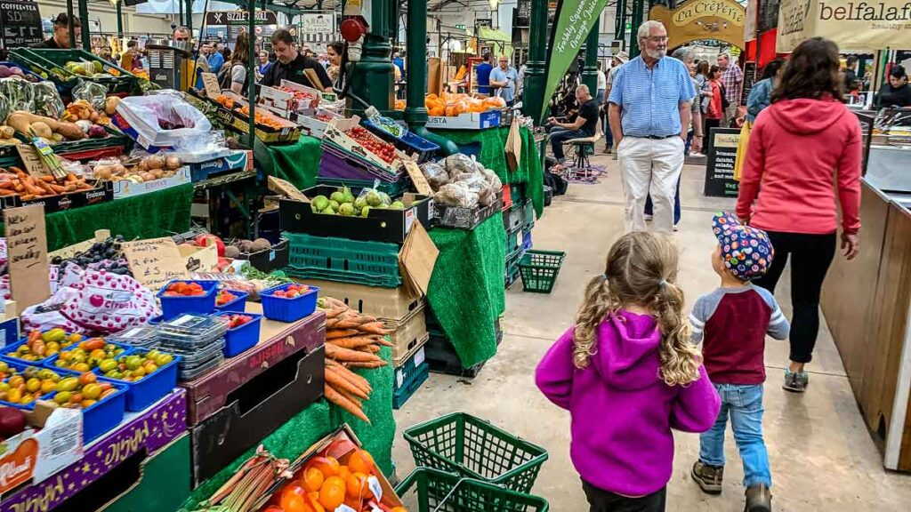 image of kids walking in St George's Market in Belfast Northern Ireland