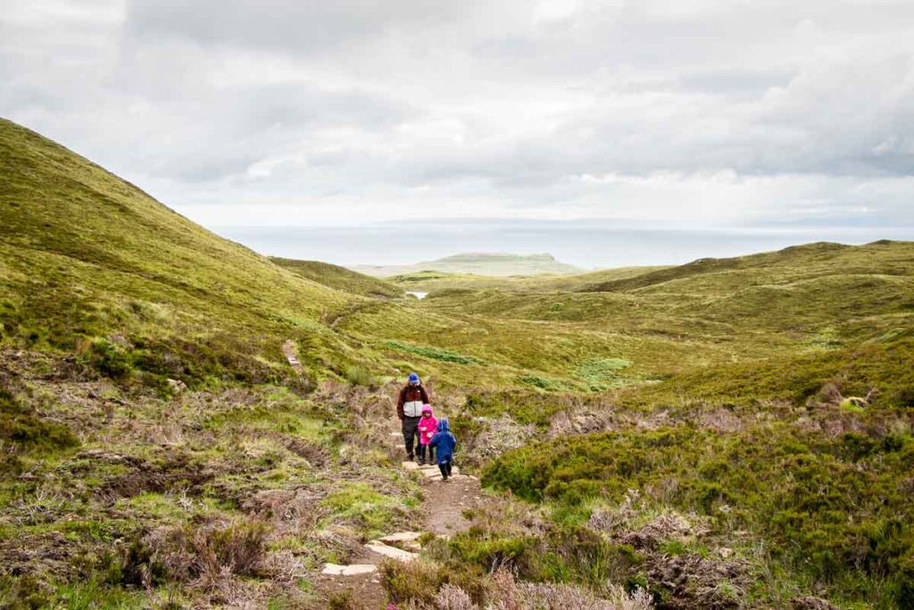 image of father hiking with kids on Isle of Skye