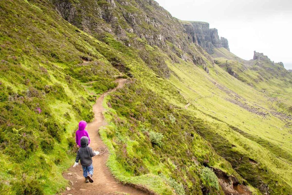 image of the Quiraing hiking trail with two kids hiking on Isle of Skye