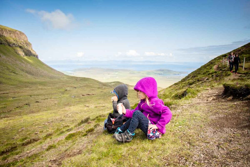 image of kids having lunch along the quiraing hike on isle of skye