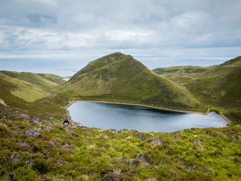 image of lake surrounded by mountains on Isle of Skye