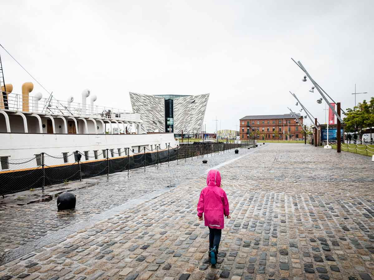 Image of girl walking towards Titanic Belfast