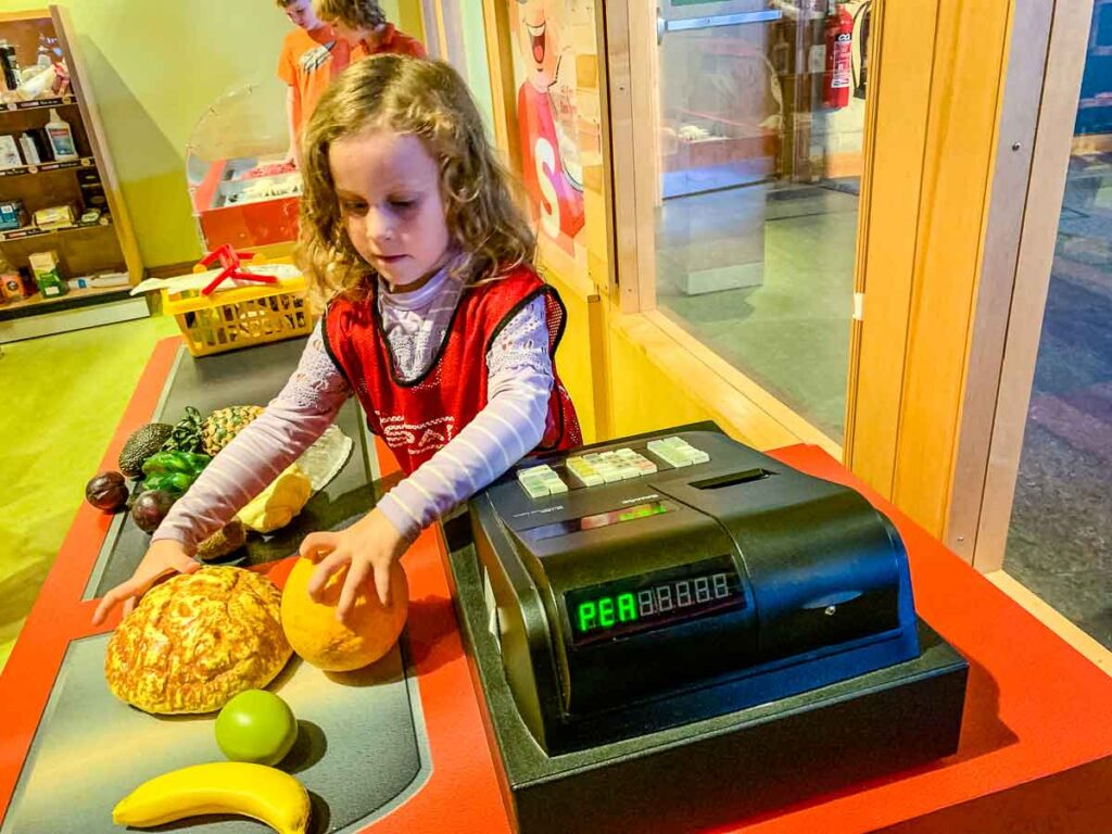image of girl playing grocery cashier at W5 in Belfast with kids