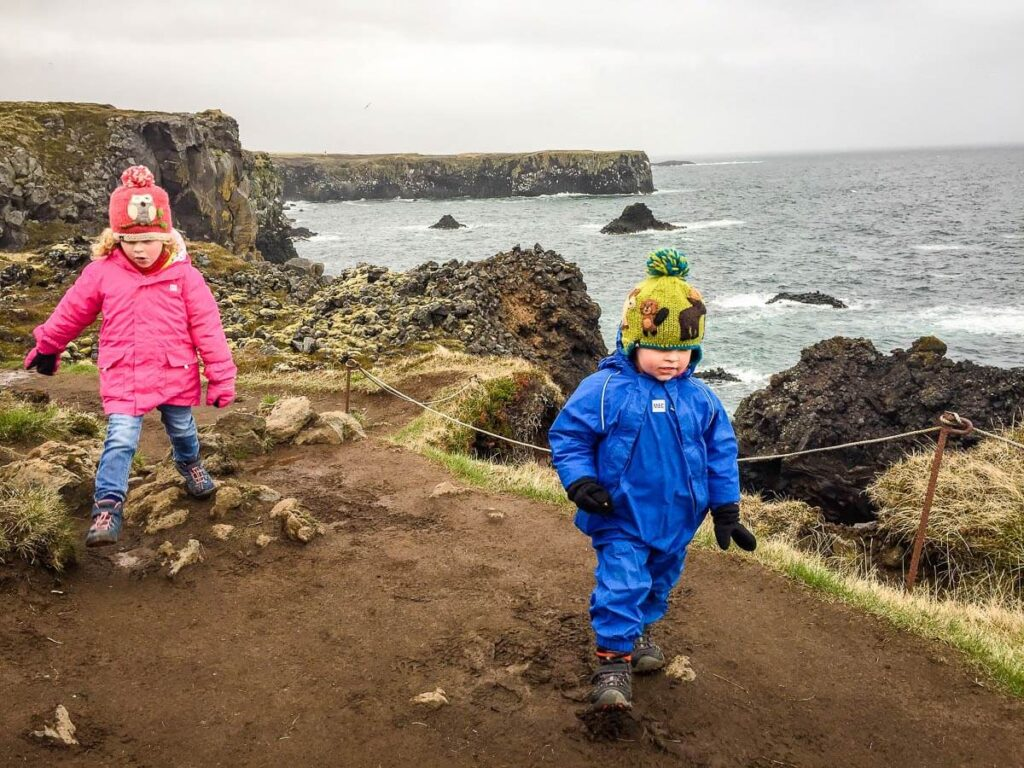 image of two kids hiking on Arnastapi to Hellnar hike in Iceland