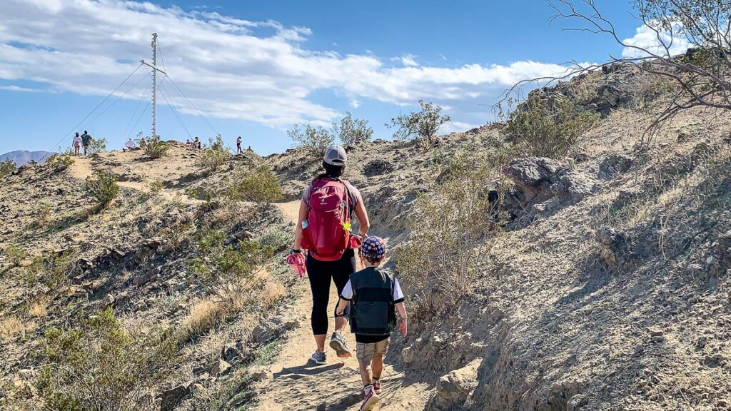 image of mother and son walking up to cross on Cross Loop Hiking Trail in Palm Springs