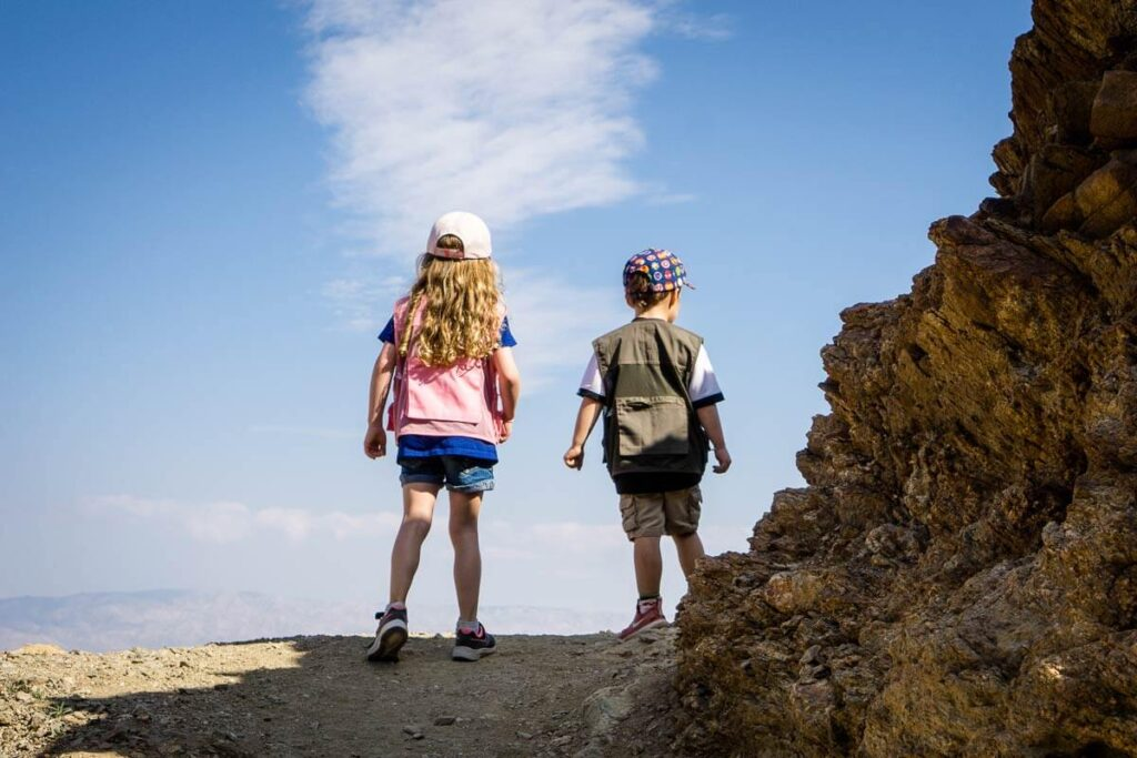 image of two kids hiking cross loop trail in Palm springs which is a kid friendly things to do in palm springs