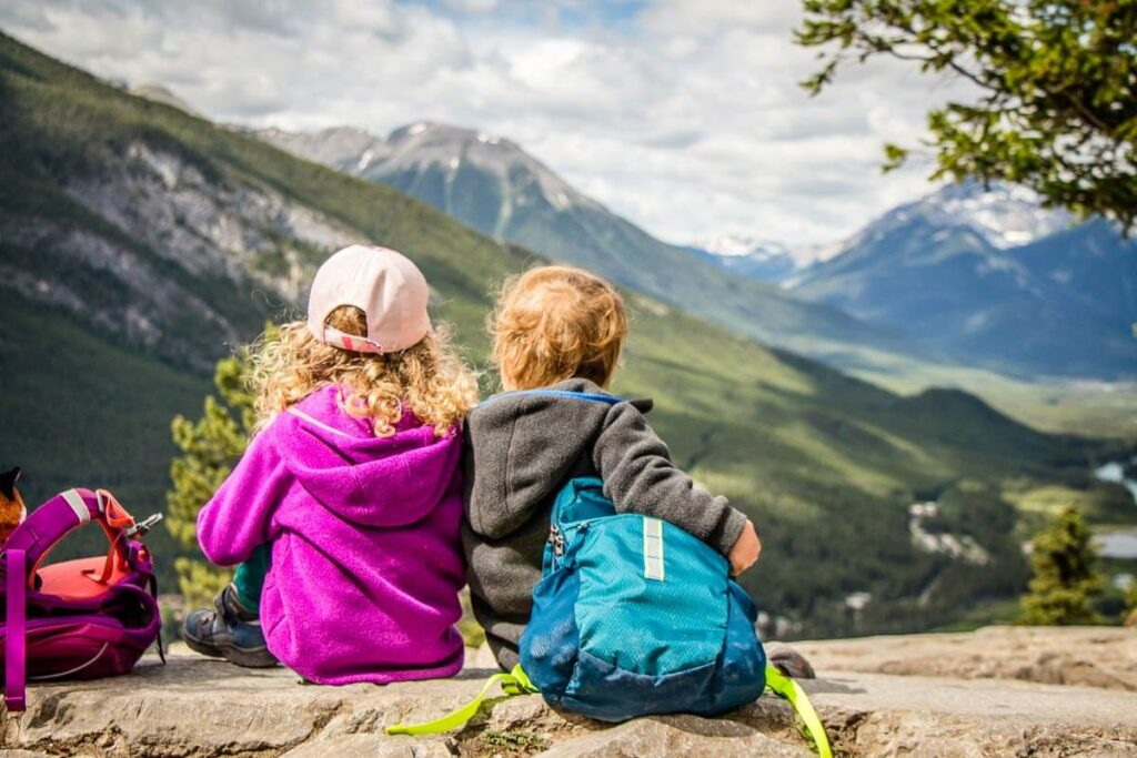 image of kids at the summit of tunnel mountain in banff national park