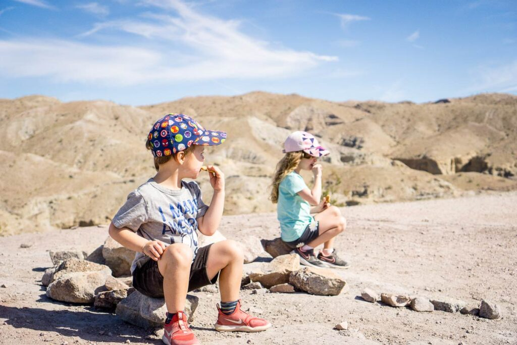 image of two kids eating a snack along Ladder Canyon trail in Palm Springs